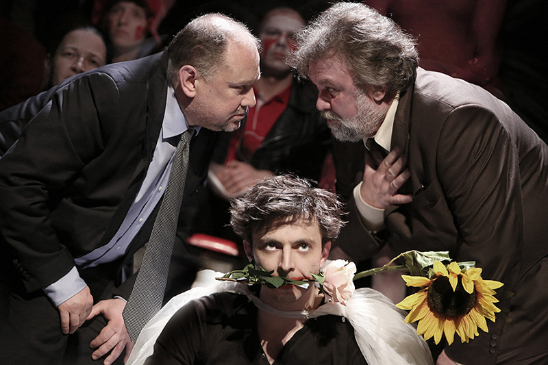 Claudius and Polonius scheming behind an insane Hamlet's back.