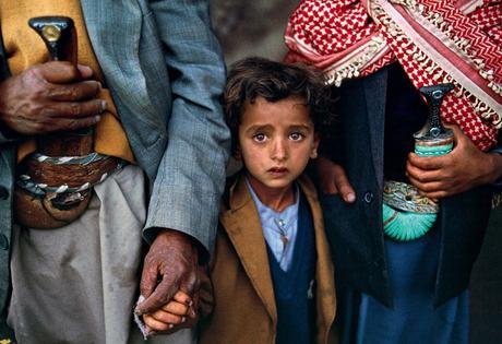 Child with relatives, Yemen
